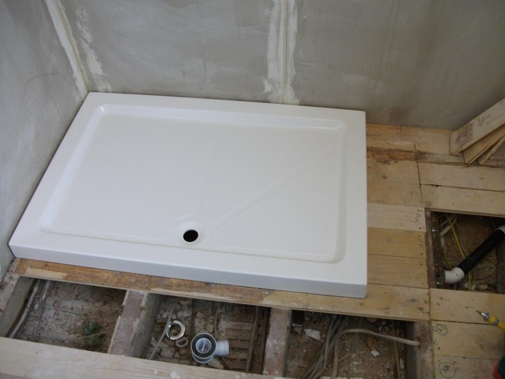 Fitting And Testing Shower Tray Wilsons Plumbing
